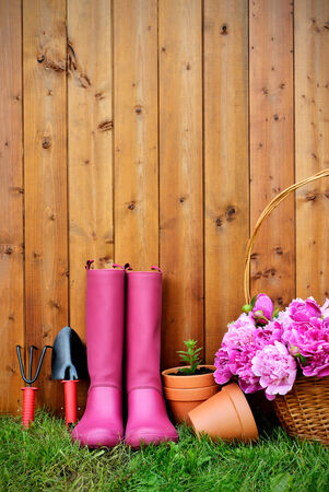 metal spring: Gardening tools and objects on old wooden background