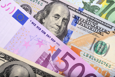 eur: Dollar and euro bank notes on the table