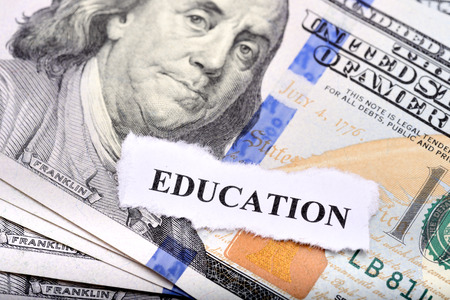education loan: Education loan concept with dollar note and paper on foreground Stock Photo