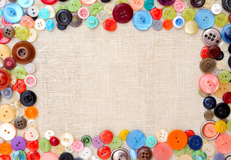 blue button: Copyspace image with multicolored sewing buttons Stock Photo