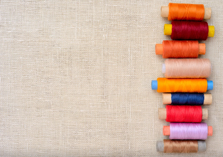 seamstress: Copyspace image with sewing threads Stock Photo