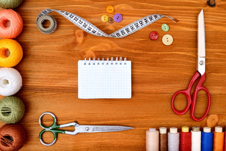 sewing item: Copyspace frame with sewing tools and accesories on wooden background