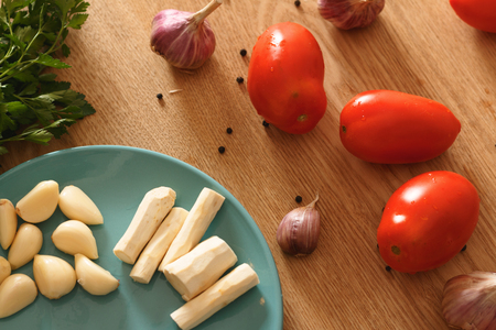 ingredients for cooking sauce of tomatoes, garlic and horseradish