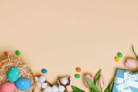 Easter composition on a beige background. Top view banner with copy space flat lay greeting card.