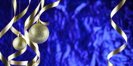 Christmas background, new year. Gold Christmas balls and streamers, blue backdrop