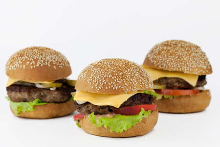 Group of burgers isolated on light background, background out of focus Banco de Imagens