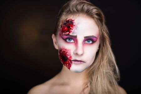 sores: Pretty woman wound splinter in the skin, bloody part of face. Perfect new idea for advertisement, banner, Halloween party card. Cosplay idea beauty monster, sexy shoulders blood lips. Young white face