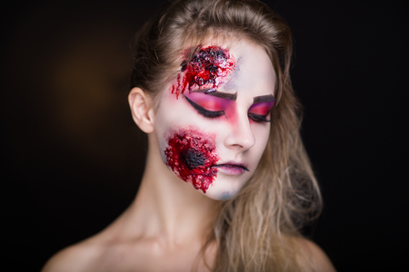 splinter: Pretty woman wound splinter in the skin, bloody part of face. Perfect new idea for advertisement, banner, Halloween party card. Cosplay idea beauty monster, sexy shoulders blood lips. Young white face
