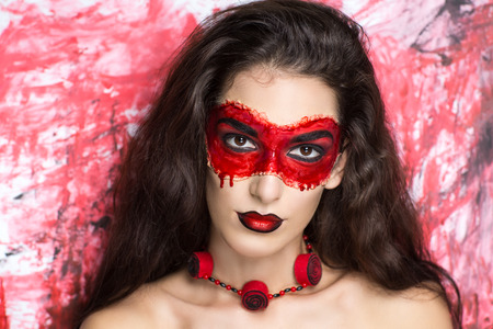 fantasy makeup: Young beautiful girl woman lady witch black bride widow. cemetery, horrible background darkness power death. Bright fantasy makeup, red lips, blood mask, expressive eyebrows. Chic look for Halloween Stock Photo