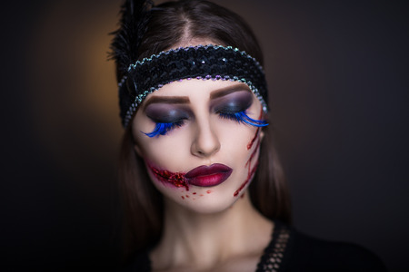 splinter: Pretty woman wound knife splinter in the skin, bloody part of face. Perfect idea for new advertisement, banner, Halloween party card. Cosplay idea beauty monster red blood lips. Young beautiful face