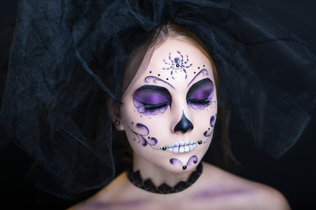 spider: Day of the Dead, Skull Mask. Art woman beautiful face painted as a traditional day of the dead, spider net on head. Free place on photo for congratulations. Good for Halloween card present big banner Stock Photo