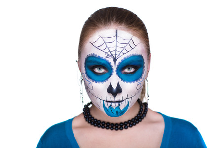 mad girl: Day of the Dead, Skull Mask. Art woman beautiful face painted as a traditional day of the dead, blue flowers on head. Free place on photo for congratulations. Good for Halloween card, present, banner
