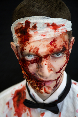 horror: Dangerous Alive Zomby. Professional make up for new horror film makeup faceart bodyart aqua grim, cosmetics. Realistic photo. Can be used for Halloween party, vampire saloon studio of horror crazy