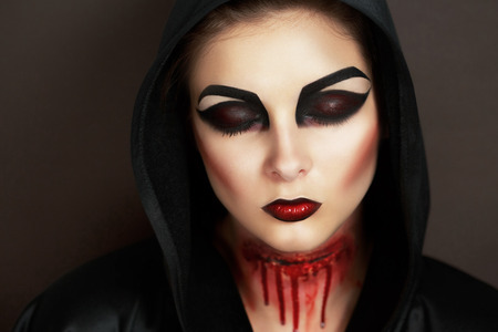 demoniacal: Female vampire with blood stains stage blood. Pretty woman with perfect face, smoky eyes, black red lips sexy mouth, professional art make up. Evil crime murderer, offence furious lady, be a victim