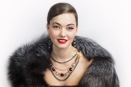 Retro style woman portrait perfect face, professional make up bright red lips, big eyes, sexy shoulders, expensive jewelry necklace earrings, stylish hair dress. Vip person one million baby love money