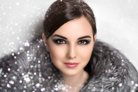 woman hairstyle: Portrait of beautiful young girl, lady, woman, model, actress, star, celebrity. Winter, New Year, Christmas, luxury, wealth. Elegant look, spectacular makeup, smoky eyes, ideal eyebrows,chic hairstyle