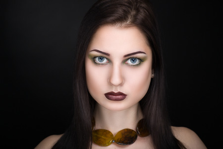 chic woman: Young beautiful woman lady model woman actress. Luxury bright stylish look. Chic impressive appearance. Perfect face smoky eyes makeup brown eyebrows arrows, sexy dark brown lips. Necklace jewelry