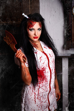role play: Black haired beautiful killer nurse from the hospital. Bloody Syringe sticking in the head and the brain follows. mad house role play game, sexy dress white coat bruising dirty blood. Happy Halloween