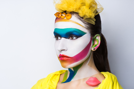 surrealistic: Surrealistic painting on the face of beautiful young girl. The world of fantasy, illusions, hallucinations. The artist created a new geometric world, conceptual art, professional photo. Bright faceart