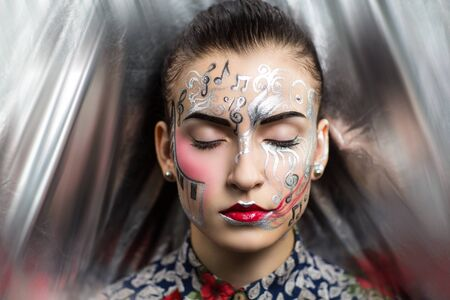 showy: Portrait of beautiful young girl woman lady, techno pop music future progress. Ideal creative expressive makeup, silver skin face neck, shoulders stylish blouse. bright showy look new conceptual idea Stock Photo