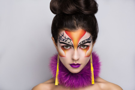 rythm: Person beautiful woman listening songs. Painted face bright art make up bodyart faceart, lady young beautiful girl. Colorful music equalizer photo bright idea. World of rythm & melody ready party time