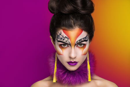 disk jockey: Person beautiful woman listening songs. Painted face bright art make up bodyart faceart, lady young beautiful girl. Colorful music equalizer photo bright idea. World of rythm & melody ready party time