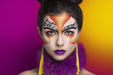 Person beautiful woman listening songs. Painted face bright art make up bodyart faceart, lady young beautiful girl. Colorful music equalizer photo bright idea. World of rythm & melody ready party time