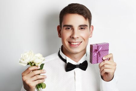 eligible: The new mens make-up for photo session, charming guy! Good for cards 14 February and 8 March, handsome face with snow-white smile will be on all the postcards and greeting. really eligible bachelor