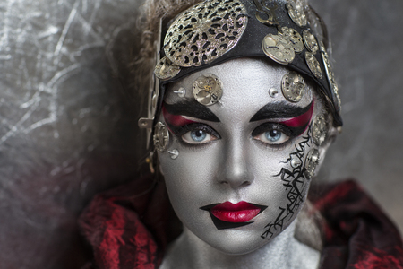 cosmo: Portrait of beautiful young girl, woman, lady, hitman, killer, techno, future, progress. Ideal creative expressive makeup, silver skin face. Stylish, bright showy look. Cosmo alien for Halloween party