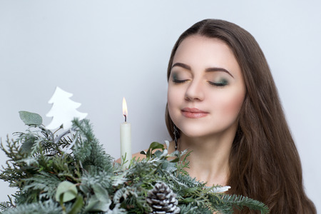 holding white christmas candle young beautiful woman lady model woman actress bright winter stylish look chic impressive appearance - Actresses In White Christmas
