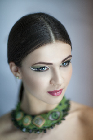 color model: Portrait of beautiful young elegant woman,girl, lady,actress, goddess, model, wealth luxury. Perfect bright color makeup, beautiful face,soft skin, natural lip, beige, gloss, straight hair, jewellery