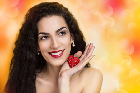 Young beautiful woman, lady, model, woman, actress. Positive, bright, summer look. Chic, impressive appearance. Perfect face, impressive makeup, eyebrows, eyes, arrows, red lips. Long curly hair.