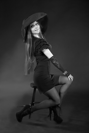 chic woman: young beautiful girl, model, woman, lady, actress. Spectacular,expressive makeup,chic long hair, flawless appearance. Vintage, retro, fashion style. Elegant dress, shoes, accessories, hat, lace gloves