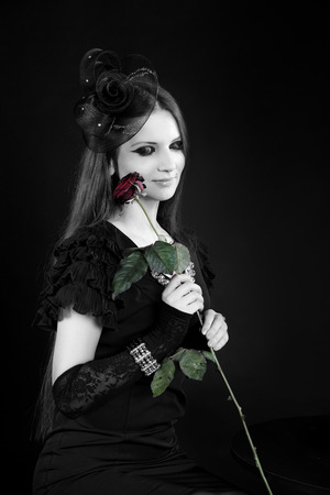 subcultures: Professional photo of young beautiful girl, model, woman, wife, mistress. Stylish dress, accessories, jewelry, gloves, lace. Holding red rose. Vintage style, dream desire, promise to love st Valentine