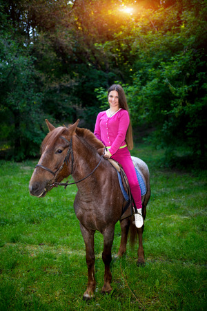 fairy  tail: Professional photo of young beautiful riding on brown horse, pinto with a spot. Forest, bright light, professional photo. Looks like film or fairy tail, cosplay. Summer time vocation, relax, go trip