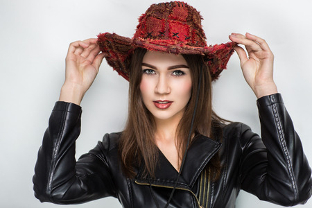 daring: Young beautiful woman, model, actress, cowboy, America, Wild West, fashion. Perfect, natural makeup, expressive eyes, lipstick, shiny, brown, caramel color. Luxurious country look, daring farm style.