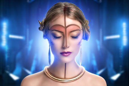fantasy makeup: young beautiful girl, model, woman, princess, character, alien. Fabulous, mystical look. Bright, creative, fantasy makeup, futurism style, gold, brown forehead, lines, pattern, nose, neck, pink lips.