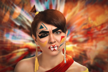 solver: Woman with creative make up, face art design in the form of yellow, red, blue, black geometric shapes. An explosion of colorful paints, powders on the background. New idea, space for text information