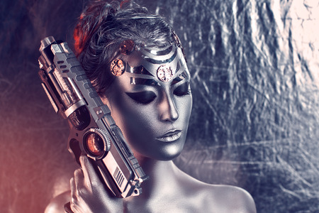 hitman: Portrait of  beautiful young girl, woman, lady, hitman, killer, techno, future, progress. Ideal creative expressive makeup, silver skin, face, neck, shoulders, hand, arms. Stylish, bright, showy look.