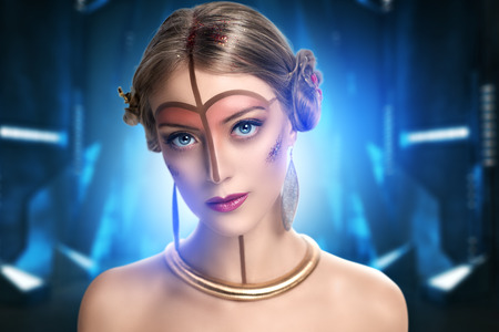 futurism: young beautiful girl, model, woman, princess, character, alien. Fabulous, mystical look. Bright, creative, fantasy makeup, futurism style, gold, brown forehead, lines, pattern, nose, neck, pink lips.