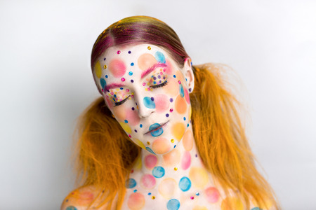 party girl: Very positive, bright, extraordinary picture. Candy Lady Art Makeup. Young smiling girl with creative body-art, vanilla girl. Party leaflet, advertisement, cosmetics, jewelry, food, blog, web-cite.