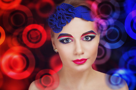 fantasy makeup: Portrait of a beautiful young girl. Bright, creative, bold, interesting, fantasy make-up. Perfect combination, rich colors . Crimson, pink, blue paint. Fabulous , mysterious, mystical appearance.