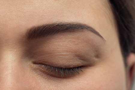 Expressive, significant eye, perfect shape of eyebrow after correction, beauty salon, pull out, have hair thinned out, care, review of the eyes, light brown coloring, natural, procedure. Young, clean 스톡 콘텐츠