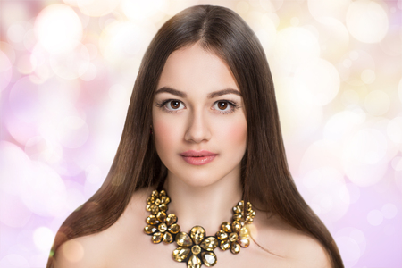 necked woman: Stylish woman portrait, necked shoulders, professional natural make up, brown hair style, clean skin, pink cheeks lips, eye brow shape, smoky eyes, expensive jewelry golden necklace. New dream fantasy Stock Photo