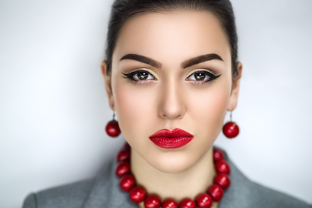 flawless: Portrait of beautiful young girl, model, woman, lady,Ukrainian, actress. Flawless bright creative makeup. Juicy red lips, expressive eyes, arrows, natural, healthy skin. Attractive stylish look.
