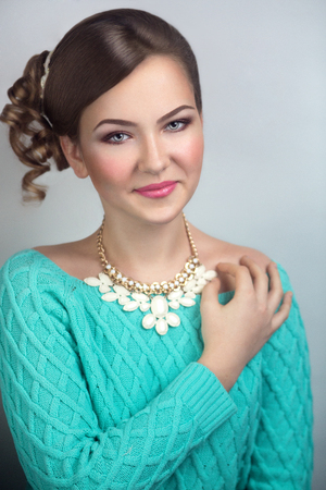 necked: Stylish woman portrait, necked shoulders, professional natural make up, curly hair style, clean skin, pink cheeks lips, eye brow shape, smoky eyes, expensive jewelry golden white necklace. New dream