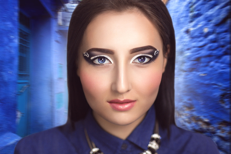 cheekbones: Portrait of a beautiful young girl, woman, model. Perfect, creative, makeup, expressive eyebrows, eyes, crystals, delicate skin tone, light blush, cheekbones. natural shine on the lips.Fashion style,look