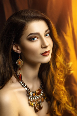 chic woman: Beautiful young woman, girl, lady, model, actress, wife, mistress. Stylish luxurious look. Expressive makeup, perfect eyebrows, eyes, lips. Color, golden, chocolate, caramel, brown. Chic hair, curls.