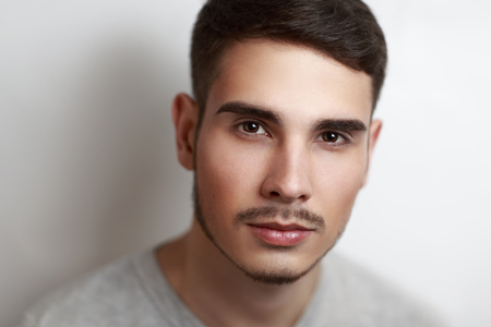 ideally: Young handsome sexy, pretty, brown-haired man, boy, model, actor. Natural makeup, expressive eyebrows, brown eyes, perfect face, nose, lips. Stylish, chic hairstyle, bright appearance. Fashion look.
