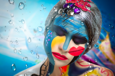 surrealistic: Surrealistic painting on the face of a beautiful young girl. The world of fantasy, illusions, hallucinations. The artist created a new underwater world, conceptual art, professional photo. Blue water